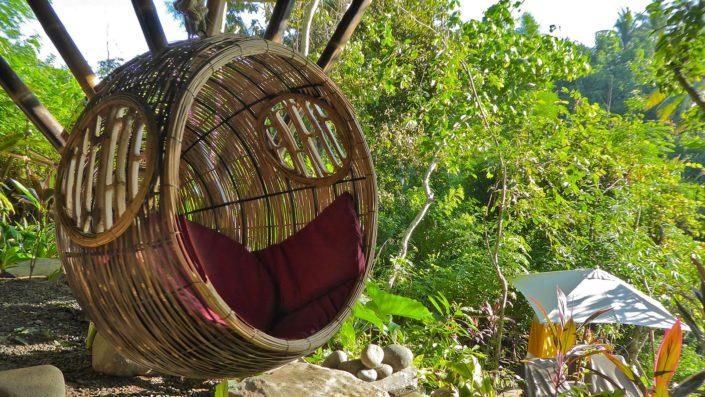 Swinging pod chair near the pool terrace