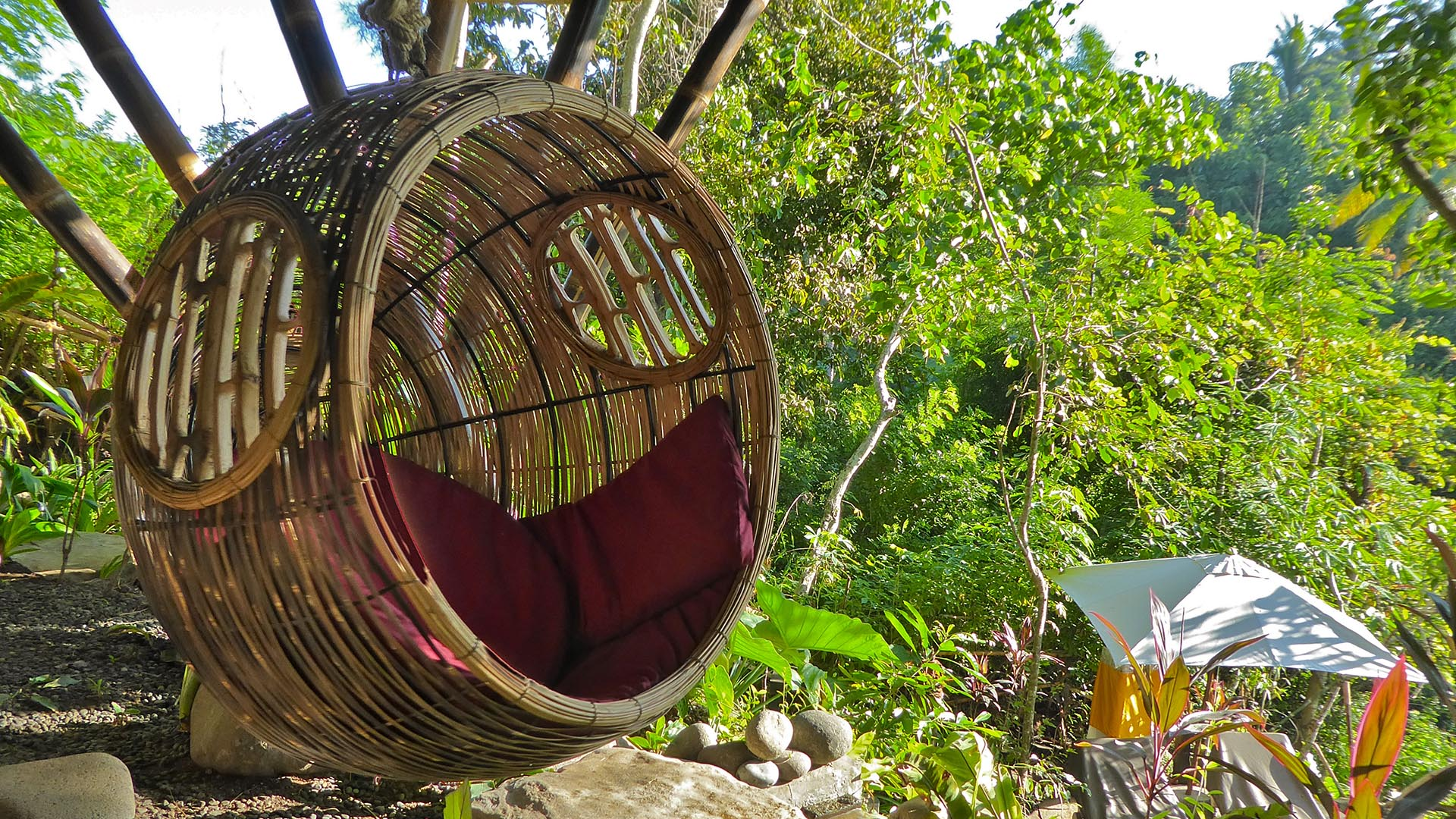 Swinging pod chair near the pool terrace